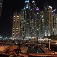 Photo taken at Dubai Marina Walk by Dona C. on 4/9/2013