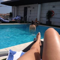 Photo taken at Piscina - NH Lisboa Liberdade by Ines D. on 7/2/2015