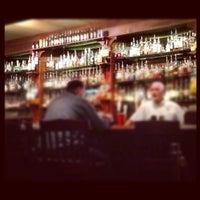 Photo taken at Downing Street Pub & Cigar Bar by Jonathan M. on 11/24/2012