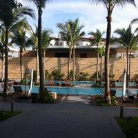 Photo taken at Nima Bay Bar & Lounge by Chufo R. on 12/12/2012