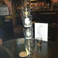 Photo taken at Hoffer's Cigar Bar by Manny L. on 3/26/2013