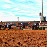 Photo taken at Lone Star Park by Knox K. on 6/8/2013