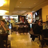 Photo taken at Olives Restaurant by Timothy S. on 4/9/2013