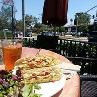 Photo taken at Coral Tree Café by Chris B. on 4/26/2013