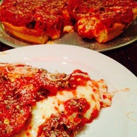 Photo taken at Kylie's Chicago Pizza by Peter A. on 12/21/2014