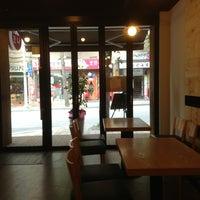 Photo taken at 코나(KONA) Cafe by Simon J. on 7/20/2013