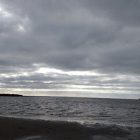 Photo taken at Swifts Beach by Ric M. on 10/13/2013