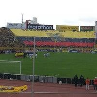 Photo taken at Estadio Olimpico Atahualpa by Carlos A. on 10/12/2012