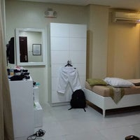 Photo taken at Empire Suites by Tinoy on 1/6/2014