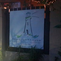 Photo taken at The Lighthouse Restaurant & Cocktail Lounge by Wynand G. on 12/28/2014