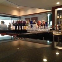Photo taken at Delta Sky Club by Brian T. on 5/22/2013