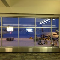 Photo taken at Gate G21 by Brian T. on 12/30/2013