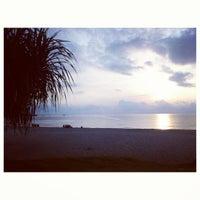 Photo taken at Pantai Teluk Cempedak (Beach) by WKeong W. on 3/22/2013