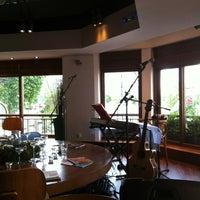 Photo taken at Θέατρον Cafe by Gönül B. on 11/24/2012