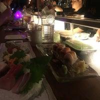 Photo taken at Amami Bar & Restaurant by Lauren B. on 8/7/2016