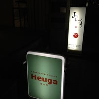Photo taken at Heuga BAR by Yuya T. on 12/11/2012