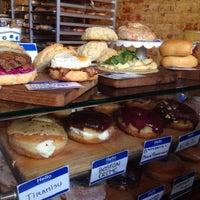 Photo taken at DISTRICT. Donuts. Sliders. Brew. by 🐙 Kellichka K. on 8/18/2015