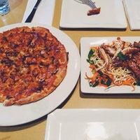 Photo taken at Boston Pizza by Hyoeun K. on 1/4/2014