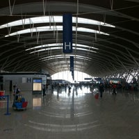 Photo taken at Shanghai Pudong International Airport (PVG) by Camilo L. on 10/7/2012