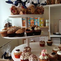 Photo taken at MoMade Cupcakes by ChrisTine M. on 7/12/2013