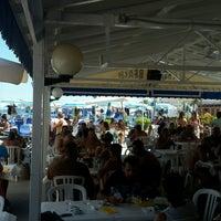 Photo taken at caesar's beach bar restaurant by Riccardo P. on 8/14/2016