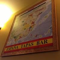 Photo taken at Espana Tapas Wine Bar by Celest on 4/21/2013