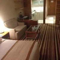 Photo taken at 西美商务酒店 by David C. on 4/19/2013