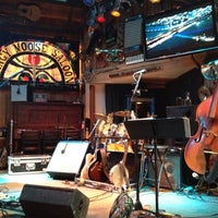 Photo taken at Mangy Moose Restaurant and Saloon by Richie J. on 7/14/2013
