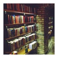Photo taken at Minoa Bookstore & Café by Koray on 12/6/2014