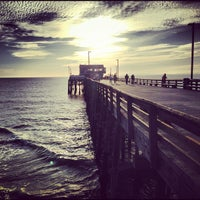 Photo taken at Newport Pier by Sean C. F. on 12/29/2012