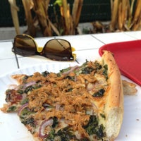 Photo taken at Wildflour Pizza by Emily Snow C. on 3/7/2014