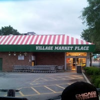 Photo taken at Village Marketplace by NEGRiTOo.... on 7/20/2012