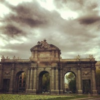 Photo taken at Alcalá Gate by Roberto D. on 4/11/2012