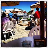 Photo taken at Salty Dog Cafe-Waterside Deck by Andrew N. on 6/16/2012