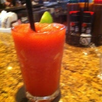 Photo taken at Smokey Bones Bar and Fire Grill by Shelly W. on 2/19/2012