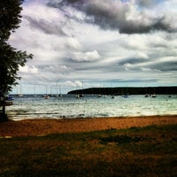 Photo taken at Fish Creek Beach by Eric S. on 7/7/2012