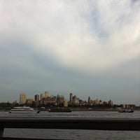 Photo taken at East River Esplanade South Dog Run by Dea S. on 9/6/2012
