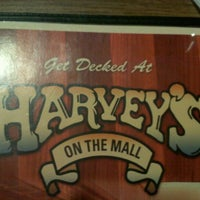 Photo taken at Harvey's on the Mall by Lauryn H. on 4/24/2012