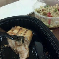 Photo taken at AJ's Fine Foods by Bryan M. on 5/2/2012