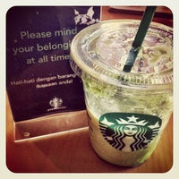 Photo taken at Starbucks by Reza N. on 5/29/2012