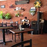 Photo taken at Savory Cafe & Bakery by Jennifer R. on 7/8/2012