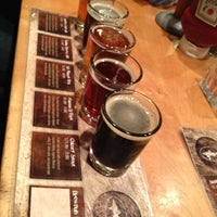 Photo taken at Dogfish Head Brewings & Eats by Julie M. on 3/31/2012