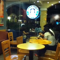 Photo taken at Starbucks Coffee by Rowell H. on 8/19/2012