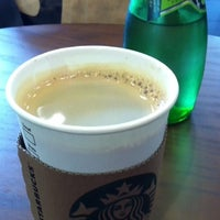 Photo taken at Starbucks by philomenus k. on 8/23/2012