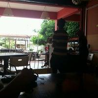 Photo taken at Melati Cafe by Camie L. on 4/11/2012