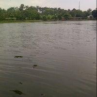 Photo taken at Situ Sawangan by Sukria C. on 4/18/2012