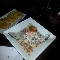 Photo taken at Cuzco Restaurante Peruano by Darío O. on 7/7/2012