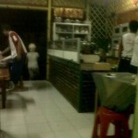 Photo taken at GaRaZi Kitchen by Erick I. on 4/4/2012