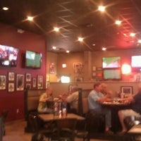 Photo taken at Brann's Sports Grille by Christie H. on 7/13/2012