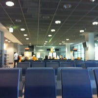 Photo taken at Gate C16 by Alex S. on 4/23/2012